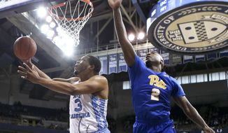 North Carolina's Kennedy Meeks (3) shoots after getting by Pittsburgh's Michael Young (2) during the first half of an NCAA college basketball game, Saturday, Feb. 25, 2017, in Pittsburgh. (AP Photo/Keith Srakocic)
