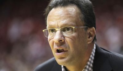 Indiana head coach Tom Crean watches during the first half of an NCAA college basketball game against Northwestern, Saturday, Feb. 25, 2017, in Bloomington, Ind. (AP Photo/Darron Cummings)