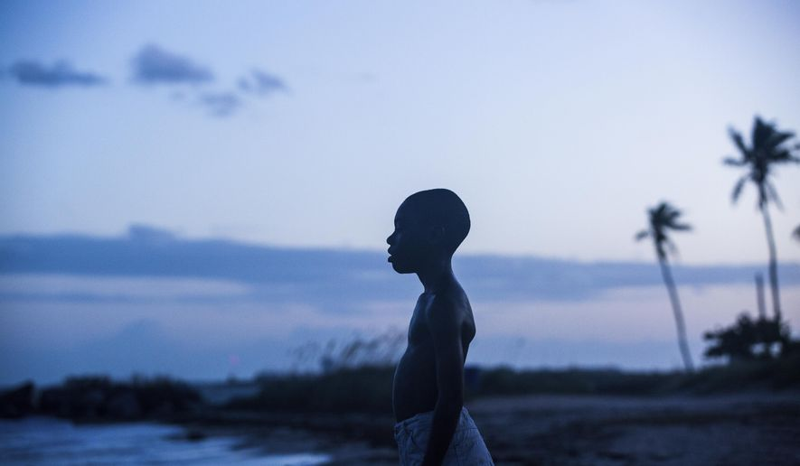 "This image released by A24 Films shows Alex Hibbert in a scene from the film, ""Moonlight."" The film is nominated for an Oscar for best picture. The 89th Academy Awards will take place on Feb. 26. (David Bornfriend/A24 via AP)"
