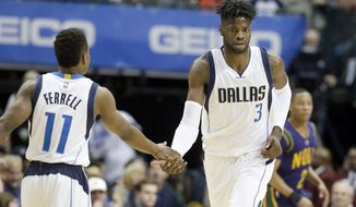 Dallas Mavericks forward Nerlens Noel (3) is congratulated by teammate Yogi Ferrell (11) after scoring during the first half of an NBA basketball game against the New Orleans Pelicans in Dallas, Saturday, Feb. 25, 2017. (AP Photo/LM Otero)