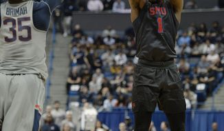 SMU's Shake Milton, right, shoots a three point basket over Connecticut's Amida Brimah, left, in the first half of an NCAA college basketball game, Saturday, Feb. 25, 2017, in Hartford, Conn. (AP Photo/Jessica Hill)