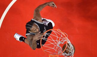 San Antonio Spurs forward Kawhi Leonard dunks during the first half of the team's NBA basketball game against the Los Angeles Clippers, Friday, Feb. 24, 2017, in Los Angeles. (AP Photo/Mark J. Terrill)