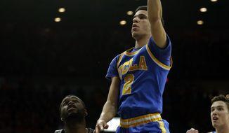 UCLA guard Lonzo Ball (2) shoots over Arizona guard Kadeem Allen during the first half of an NCAA college basketball game, Saturday, Feb. 25, 2017, in Tucson, Ariz. (AP Photo/Rick Scuteri)