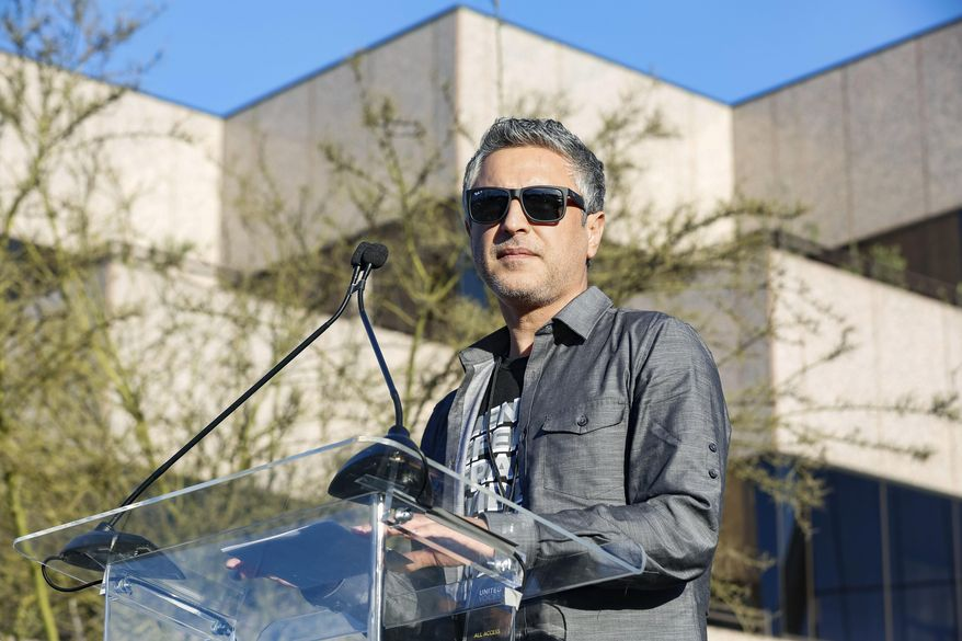 """Reza Aslan speaks at the UTA """"United Voices"""" Rally at United Talent Agency headquarters on Friday, Feb. 24, 2017, in Beverly Hills, Calif. As most of Hollywood gears up for the Oscars on Sunday and the whirlwind of events and parties this weekend, celebrities and top talent agents gathered in Beverly Hills Friday to do something to do something a little different: rally for immigration rights. (Photo by Willy Sanjuan/Invision/AP)"""