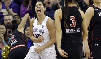 Washington's Kelsey Plum reacts after scoring against Utah in the second half of an NCAA college basketball game Saturday, Feb. 25, 2017, in Seattle. Plum surpassed Jackie Stiles to become the NCAA's all-time scoring leader with a career-best 57 points in the final regular season game of her career, leading No. 11 Washington past Utah 84-77 on Saturday. (AP Photo/Elaine Thompson)