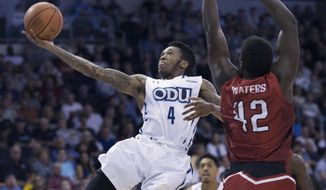 Old Dominion's Ahmad Caver drives to the basket past the defense of Western Kentucky's Anton Waters during the first half of an NCAA college basketball game Saturday, Feb. 25, 2017, in Norfolk, Va. (L. Todd Spencer/The Virginian-Pilot via AP)