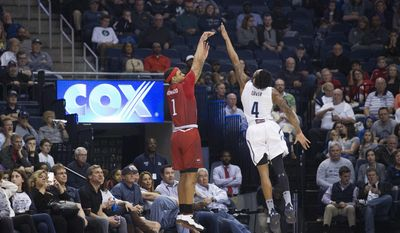 Old Dominion University's Ahmad Caver (4) tries to defend the shot of Western Kentucky's Tobias Howard during the first half of an NCAA college basketball game Saturday, Feb. 25, 2017, in Norfolk, Va. (L. Todd Spencer/The Virginian-Pilot via AP)