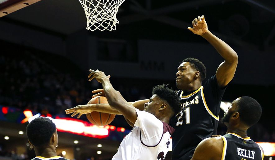 Missouri State forward Alize Johnson (24) has his shot blocked by Wichita State forward Darral Willis Jr. (21) during the first half of an NCAA college basketball game in Springfield, Mo., Saturday, Feb. 25, 2017. (Guillermo Hernandez Martinez/The Springfield News-Leader via AP)