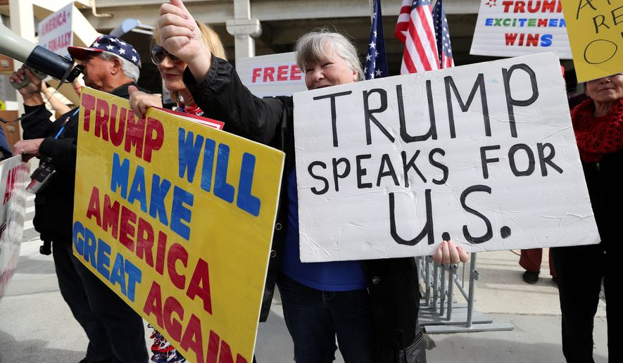Demonstrators at Los Angeles International Airport showed support for President Trump's executive order banning travel to the U.S. from seven primarily Muslim nations. (Associated Press)