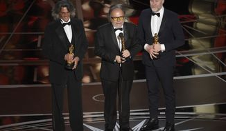 "Giorgio Gregorini, from left, Alessandro Bertolazzi, and Christopher Allen Nelson accept the award for best makeup and hairstyling for ""Suicide Squad"" at the Oscars on Sunday, Feb. 26, 2017, at the Dolby Theatre in Los Angeles. (Photo by Chris Pizzello/Invision/AP)"