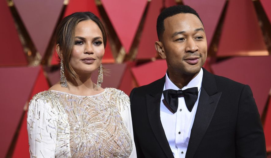 Chrissy Teigen, left, and John Legend arrive at the Oscars on Sunday, Feb. 26, 2017, at the Dolby Theatre in Los Angeles. (Photo by Richard Shotwell/Invision/AP) ** FILE **