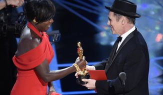 "Mark Rylance, right, presents Viola Davis with the award for best actress in a supporting role for ""Fences"" at the Oscars on Sunday, Feb. 26, 2017, at the Dolby Theatre in Los Angeles. (Photo by Chris Pizzello/Invision/AP)"