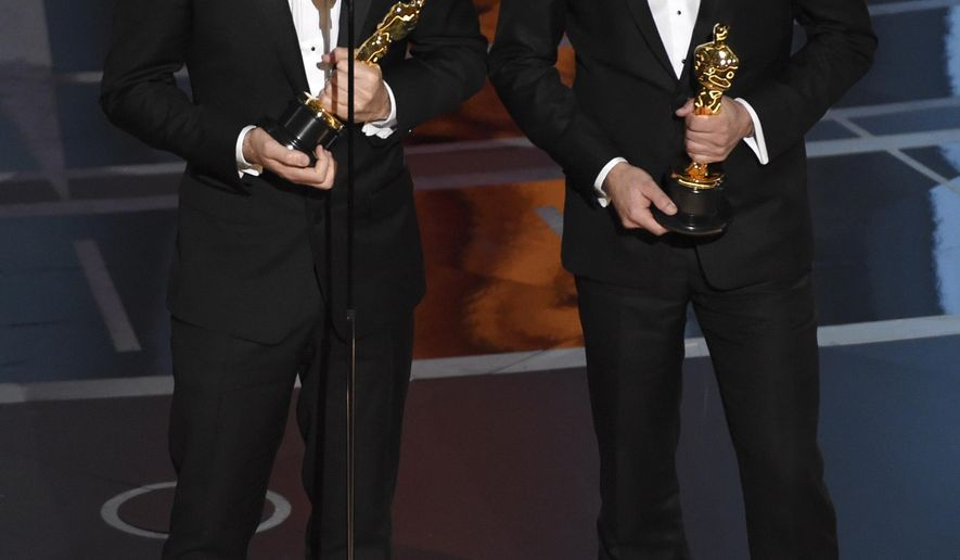 """Alan Barillaro, left, and Marc Sondheimer accept the award for best animated short film for """"Piper"""" at the Oscars on Sunday, Feb. 26, 2017, at the Dolby Theatre in Los Angeles. (Photo by Chris Pizzello/Invision/AP)"""