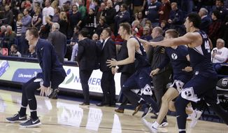 BYU players celebrate after defeating No. 1 Gonzaga 79-71 in an NCAA college basketball game in Spokane, Wash., Saturday, Feb. 25, 2017. (AP Photo/Young Kwak)
