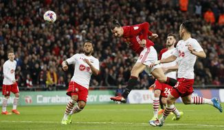 United's Zlatan Ibrahimovic scores his side's third goal during the English League Cup final soccer match between Manchester United and Southampton FC at Wembley stadium in London, Sunday, Feb. 26, 2017. (AP Photo/Kirsty Wigglesworth)