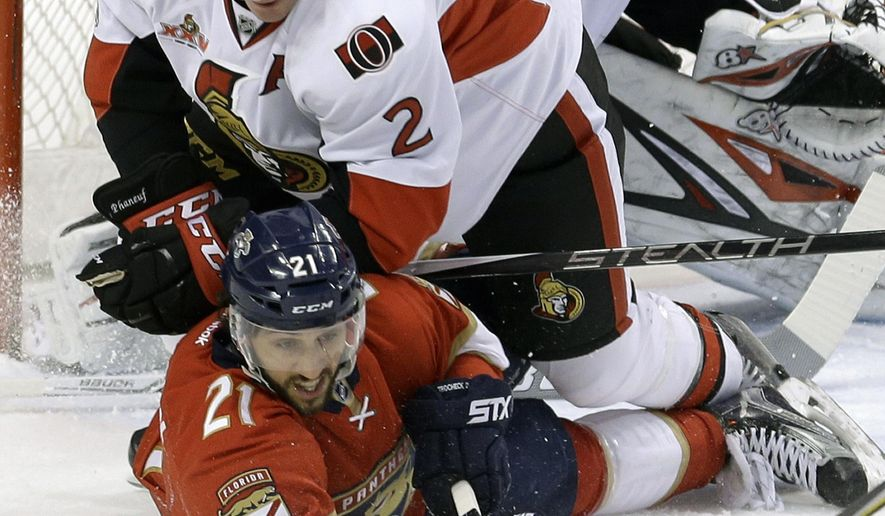 Ottawa Senators defenseman Dion Phaneuf (2) checks Florida Panthers center Vincent Trocheck (21) as they battle for the puck in the first period of an NHL hockey game, Sunday, Feb. 26, 2017, in Sunrise, Fla. (AP Photo/Alan Diaz)