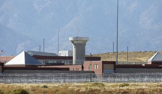 FILE - In this Oct. 15, 2015 file photo, a guard tower looms over a federal prison complex which houses a Supermax facility outside Florence, in southern Colorado. The federal prison population is on the decline, but a new attorney general who talks tough on drugs and crime could usher in a reversal of that trend. The resources of a prison system that for years has grappled with overcrowding, but that experienced a population drop as Justice Department leaders pushed a different approach to drug prosecutions, could again be taxed.  (AP Photo/Brennan Linsley,File)