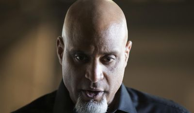 Executive Director of the Major League Players Association Tony Clark speaks ahead of a spring training baseball game between the New York Yankees and the Toronto Blue Jays on Sunday, Feb. 26, 2017, in Tampa, Fla. (AP Photo/Matt Rourke)