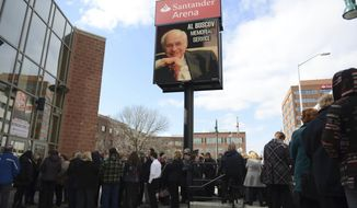 People wait to enter the memorial service for Albert Boscov at the Santander Arena, Sunday, Feb. 26, 2017 in Reading, Pa.  Late department store chairman Albert Boscov was remembered as an energetic businessman, a caring person and a tireless cheerleader for the city he loved.Hundreds gathered Sunday at a Reading arena to honor Boscov, who died Feb. 10 at age 87, and who was credited with driving the growth of the century-old business established by his father to sales in excess of $1 billion.(Lauren A. Little/Reading Eagle via AP)