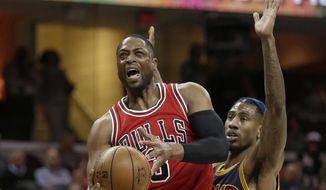 Chicago Bulls' Dwyane Wade (3) is fouled by Cleveland Cavaliers' Iman Shumpert (4) in the first half of an NBA basketball game, Saturday, Feb. 25, 2017, in Cleveland. (AP Photo/Tony Dejak) **FILE**