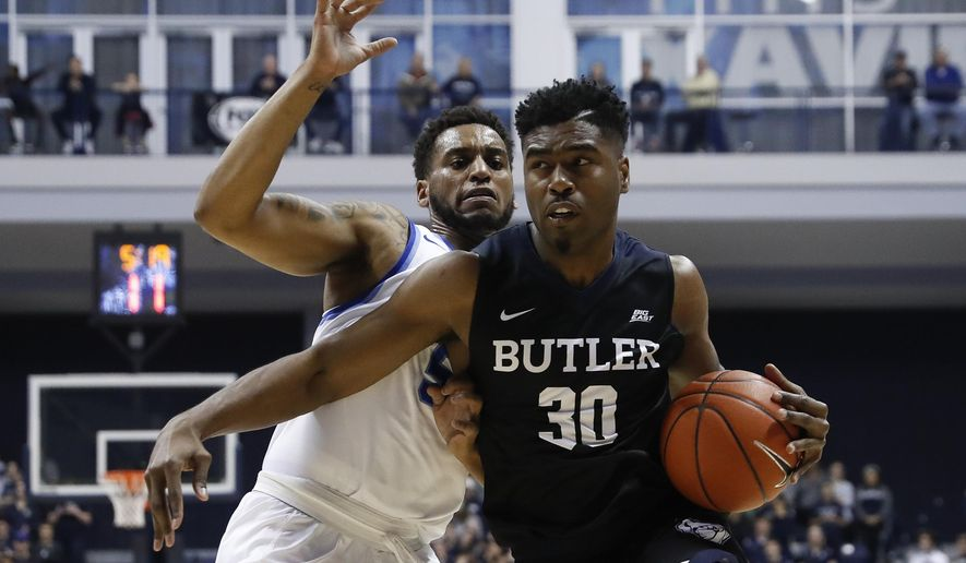 Butler's Kelan Martin (30) drives around Xavier's Trevon Bluiett, left, in the first half of an NCAA college basketball game, Sunday, Feb. 26, 2017, in Cincinnati. (AP Photo/John Minchillo)