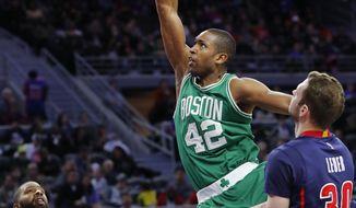Boston Celtics center Al Horford (42) dunks on Detroit Pistons forward Jon Leuer (30) in the second half of an NBA basketball game in Auburn Hills, Mich., Sunday, Feb. 26, 2017. (AP Photo/Paul Sancya)