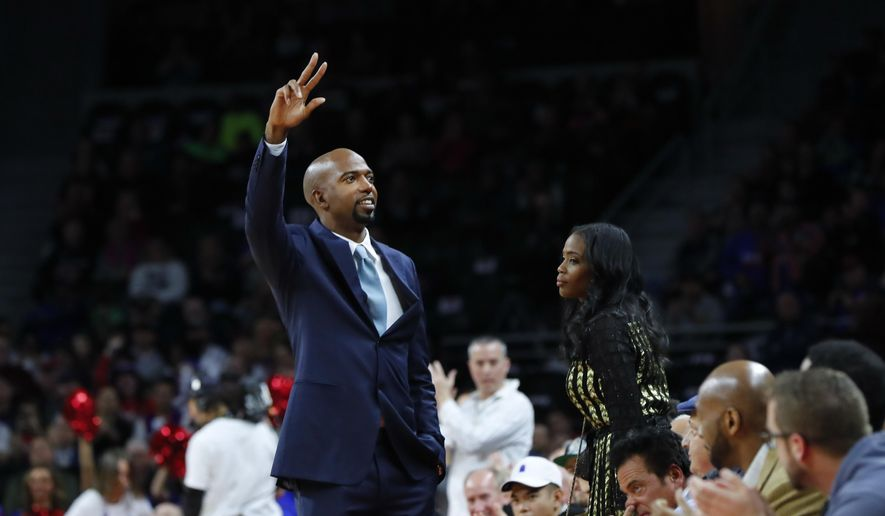 Former Detroit Pistons player Richard Hamilton waves to the crowd in the first half of an NBA basketball game against the Boston Celtics in Auburn Hills, Mich., Sunday, Feb. 26, 2017. Hamilton is having his jersey number retired. (AP Photo/Paul Sancya)