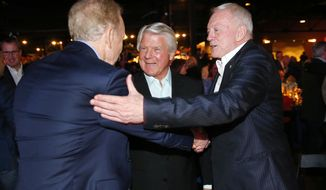Dallas Cowboys owner Jerry Jones, right, and his former Super Bowl-winning coach Jimmy Johnson, center, greet former quarterback Roger Staubach following the 25th Anniversary of Super Bowl XXVII at Gilley's in Dallas, Saturday, Feb. 25, 2017. (Tom Fox/The Dallas Morning News via AP)