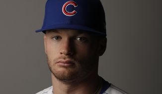 This Feb. 21, 2017 file photo shows Chicago Cubs' Ian Happ taken during the team's photo day in Mesa, Ariz. (AP Photo/Morry Gash)