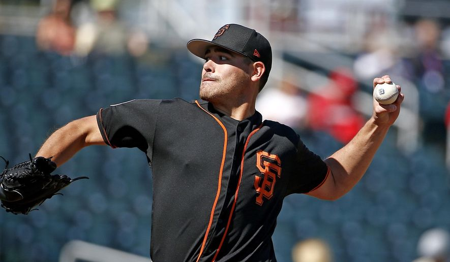 San Francisco Giants starting pitcher Matt Moore throws a pitch against the Cincinnati Reds during the first inning of a spring training baseball game, Sunday, Feb. 26, 2017, in Goodyear, Ariz. (AP Photo/Ross D. Franklin)