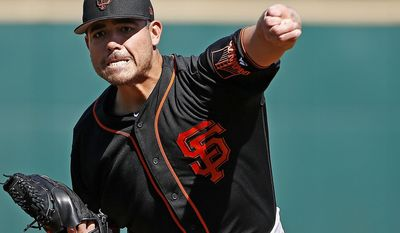 San Francisco Giants starting pitcher Matt Moore warms up during the first inning of a spring training baseball game against the Cincinnati Reds, Sunday, Feb. 26, 2017, in Goodyear, Ariz. (AP Photo/Ross D. Franklin)
