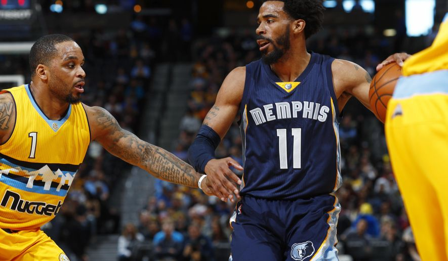 Memphis Grizzlies guard Mike Conley, right, drives the lane as Denver Nuggets guard Jameer Nelson defends in the first half of an NBA basketball game, Sunday, Feb. 26, 2017, in Denver. (AP Photo/David Zalubowski)