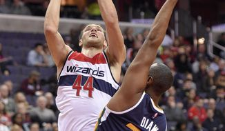 Washington Wizards guard Bojan Bogdanovic (44), of Croatia, goes to the basket against Utah Jazz center Boris Diaw (33), of France, during the first half of an NBA basketball game, Sunday, Feb. 26, 2017, in Washington. (AP Photo/Nick Wass)