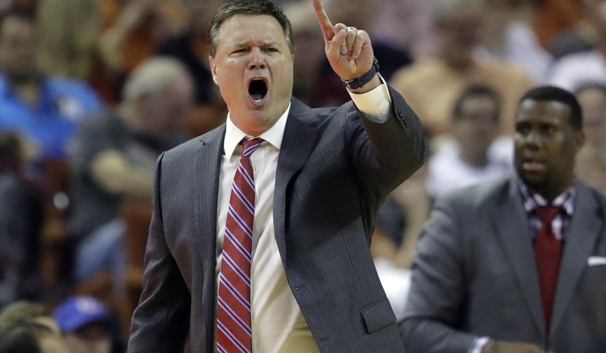 Kansas coach Bill Self calls to his players during the second half of an NCAA college basketball game against Texas, Saturday, Feb. 25, 2017, in Austin, Texas. Kansas won 77-67. (AP Photo/Eric Gay)