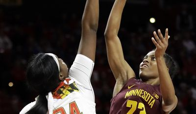 Maryland forward Brianna Fraser, left, blocks a shot attempt by Minnesota guard Kenisha Bell in the first half of an NCAA college basketball game, Sunday, Feb. 26, 2017, in College Park, Md. (AP Photo/Patrick Semansky)