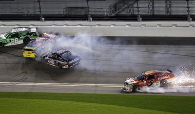 Dakoda Armstrong (28), Matt Tifft (19), Brandon Hightower (40) and Michael Annett (5) crash on the final lap of the Xfinity Series auto race at Daytona International Speedway, Saturday, Feb. 25, 2017, in Daytona Beach, Fla. (AP Photo/John Raoux)