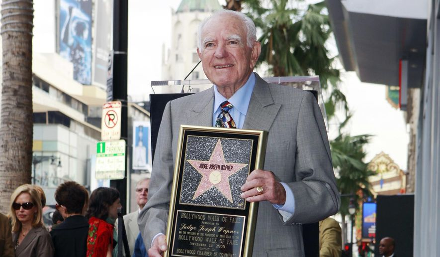 "In this Thursday, Nov. 12, 2009, file photo, Judge Joseph Wapner is honored with star on the Hollywood Walk of Fame in Los Angeles. Wapner, who presided over ""The People's Court"" with steady force during the heyday of the reality courtroom show, has died. Wapner died at home in his sleep Sunday, Feb. 26, 2017, according to his son, David Wapner. (AP Photo/Damian Dovarganes)"