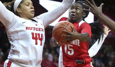 Ohio State guard Linnae Harper (15) looks to make a basket as Rutgers center Jordan Wallace (44) defends during the first half of an NCAA college basketball game, Sunday, Feb. 26, 2017, in Piscataway, N.J. (AP Photo/Mel Evans)