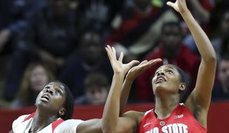 Ohio State forward Tori McCoy (0) and Rutgers center Victoria Harris (40) compete for the ball during the first half of an NCAA college basketball game, Sunday, Feb. 26, 2017, in Piscataway, N.J. (AP Photo/Mel Evans)