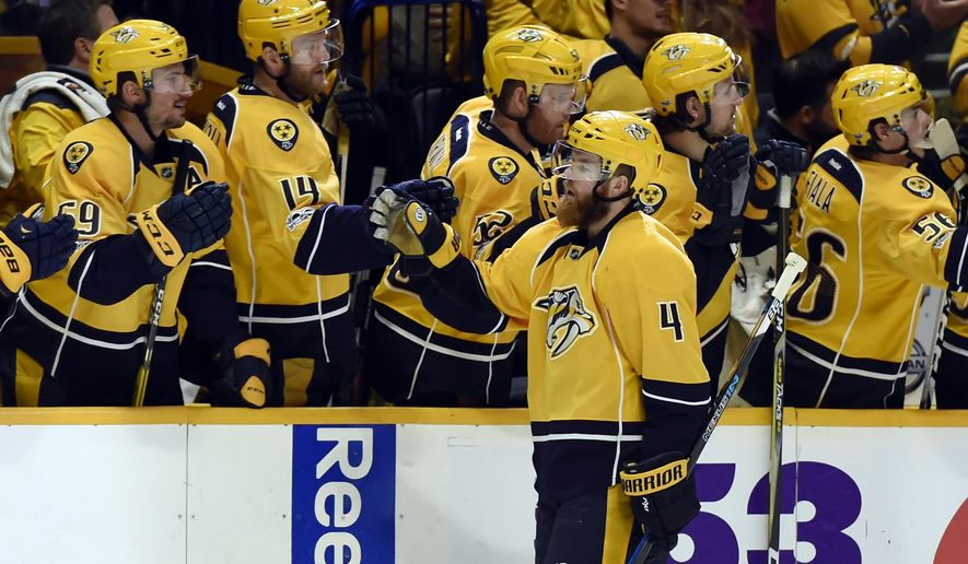 Nashville Predators defenseman Ryan Ellis is congratulated after scoring a goal against the Edmonton Oilers during the first period of an NHL hockey game Sunday, Feb. 26, 2017, in Nashville, Tenn. (AP Photo/Mark Zaleski)