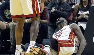 Miami Heat forward Willie Reed reacts after after sustaining an injury in the second half of an NBA basketball game against the Indiana Pacers, Saturday, Feb. 25, 2017, in Miami. Reed could not continue playing. (AP Photo/Alan Diaz)