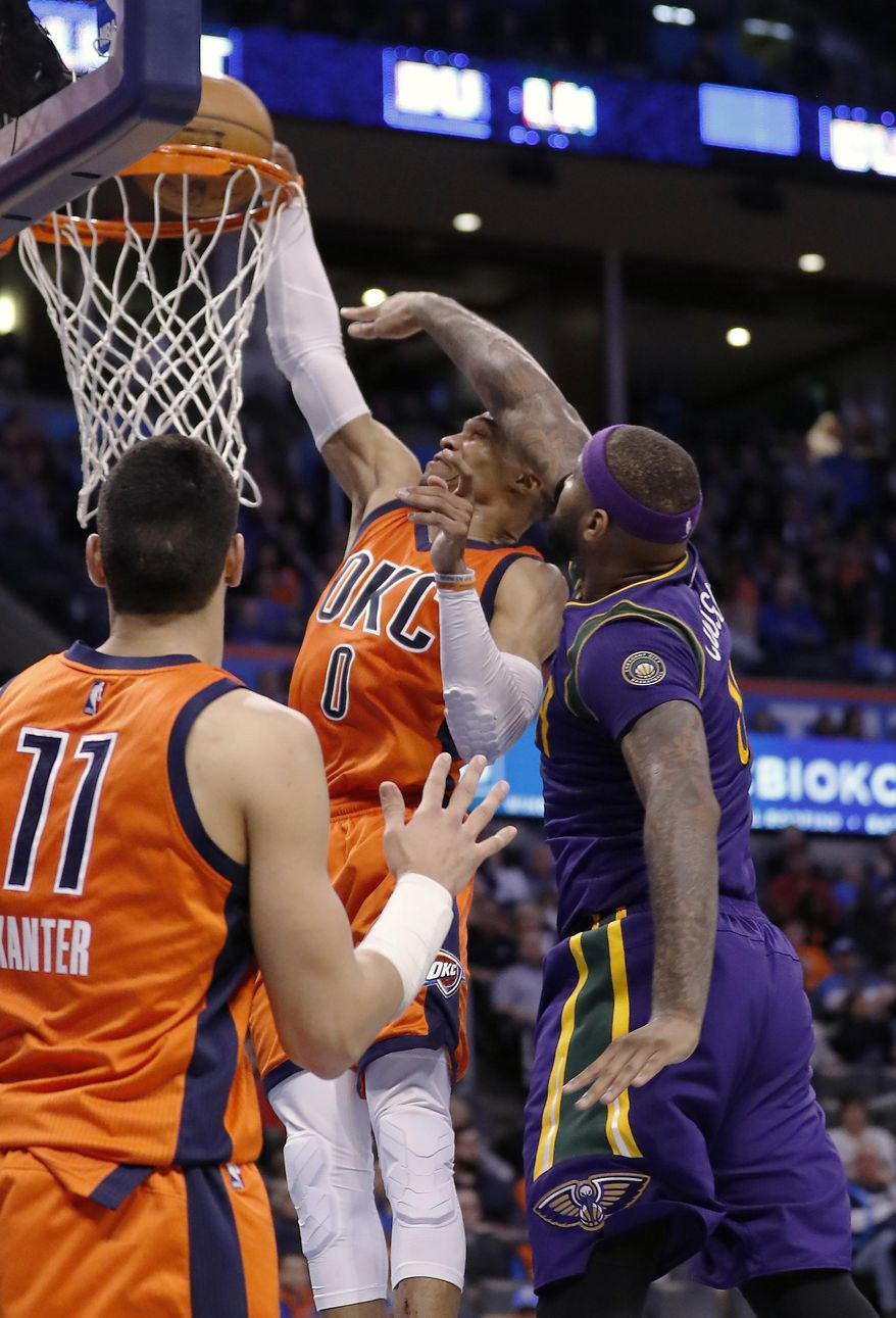 Oklahoma City Thunder guard Russell Westbrook (0) is fouled by New Orleans Pelicans forward DeMarcus Cousins (0) during the second half of an NBA basketball game in Oklahoma City, Sunday, Feb. 26, 2017. Oklahoma City won 118-110. (AP Photo/Alonzo Adams)