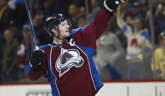 Colorado Avalanche left wing Gabriel Landeskog, of Sweden, celebrates at the end of the team's NHL hockey game against the Buffalo Sabres on Saturday, Feb. 25, 2017, in Denver. The Avalanche won 5-3. (AP Photo/David Zalubowski)