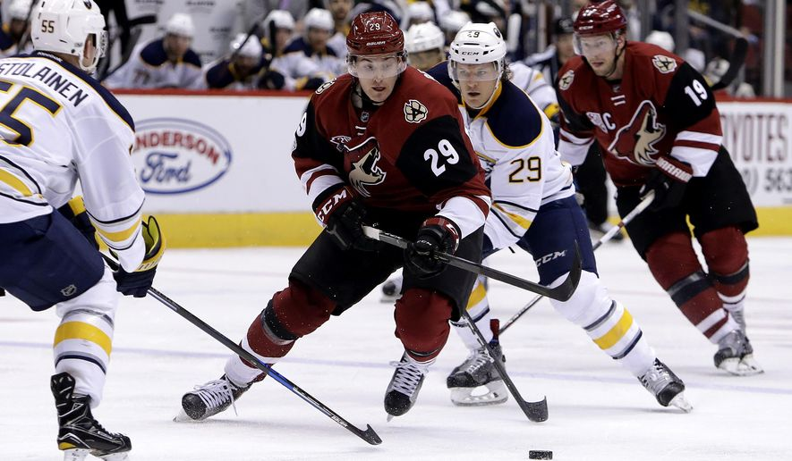 Arizona Coyotes left wing Brendan Perlini (29) skates between Buffalo Sabres defenseman Rasmus Ristolainen (55) and Jake McCabe (29) in the second period during an NHL hockey game, Sunday, Feb. 26, 2017, in Glendale, Ariz. (AP Photo/Rick Scuteri)