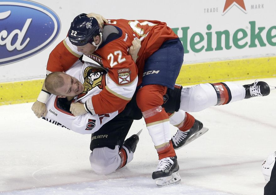 Florida Panthers left wing Shawn Thornton (22) and Ottawa Senators defenseman Mark Borowiecki (74) brawl in the first period of an NHL hockey game, Sunday, Feb. 26, 2017, in Sunrise, Fla. (AP Photo/Alan Diaz)