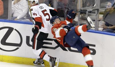 Florida Panthers center Jonathan Marchessault falls after he was checked by Ottawa Senators defenseman Cody Ceci (5) in the second period of an NHL hockey game, Sunday, Feb. 26, 2017, in Sunrise, Fla. (AP Photo/Alan Diaz)