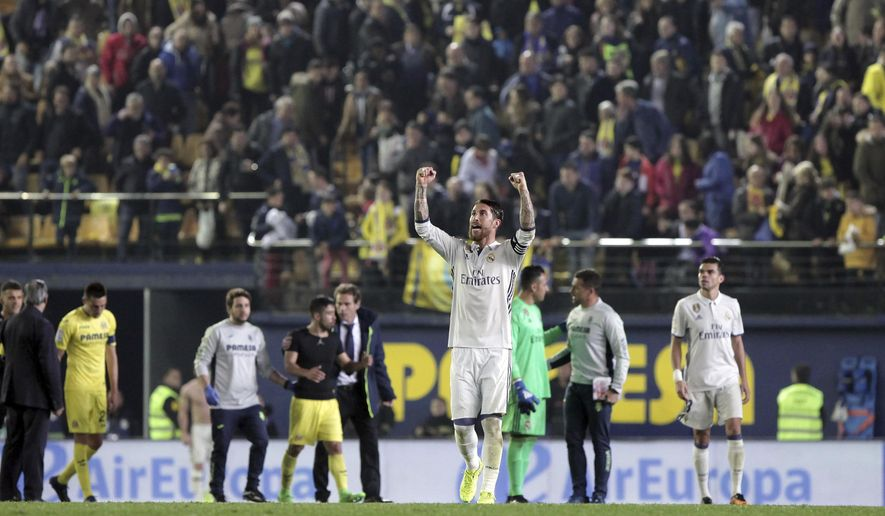 Real Madrid's Sergio Ramos celebrates victory at the end the Spanish La Liga soccer match between Valencia and Real Madrid at the Ceramica Stadium in Villarreal, Spain, Sunday, Feb. 26, 2017. (AP Photo/Jose Miguel Fernandez)