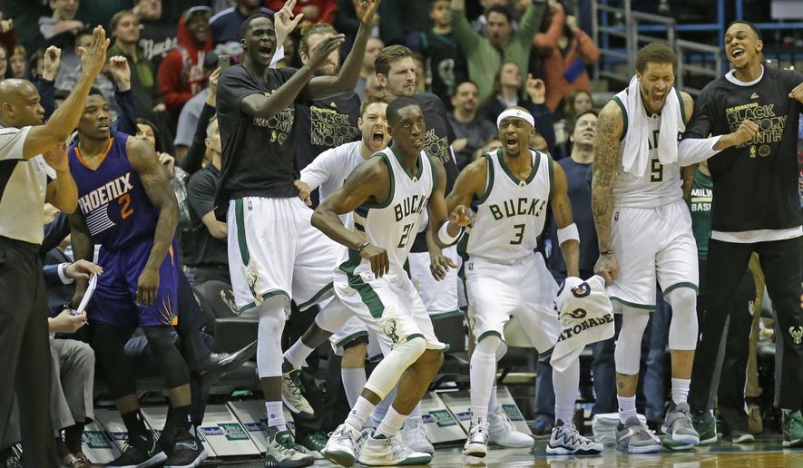 The Milwaukee Bucks bench reacts after teammate Tony Snell (2) hits a three-pointer in the closing seconds for their NBA basketball game Sunday, Feb. 26, 2017, in Milwaukee. The Bucks beat Phoenix 100-96. (AP Photo/Jeffrey Phelps)