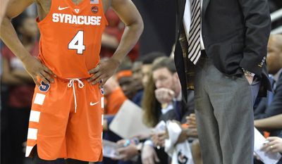 Syracuse's head coach Jim Boeheim, right, talks to Syracuse's John Gillon (4) during the first half of an NCAA college basketball game against Louisville, Sunday, Feb. 26, 2017, in Louisville, Ky. (AP Photo/Timothy D. Easley)