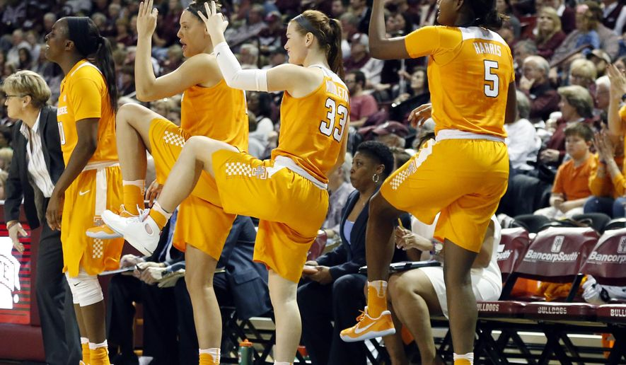 Tennessee players react to a three-point basket against Mississippi State in the first half of an NCAA college basketball game in Starkville, Miss., Sunday, Feb. 26, 2017. (AP Photo/Rogelio V. Solis)